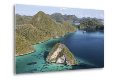 Forest-Covered Limestone Islands Surround a Lagoon in Raja Ampat-Stocktrek Images-Metal Print