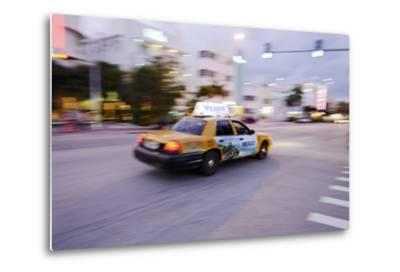 Taxi at Full Speed Early in the Evening on Collins Avenue, Miami South Beach, Florida-Axel Schmies-Metal Print