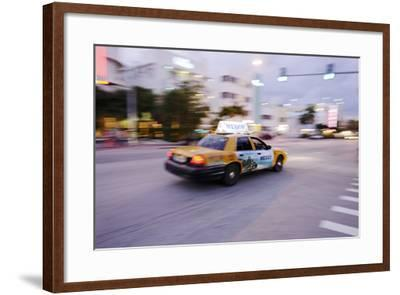 Taxi at Full Speed Early in the Evening on Collins Avenue, Miami South Beach, Florida-Axel Schmies-Framed Photographic Print
