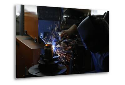 Man Welding Workpiece, Workshop, Flying Sparks- Fact-Metal Print