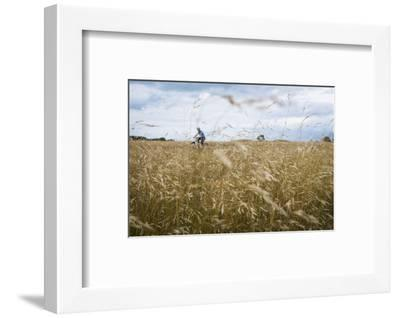 Boy with Bicycle in Grain Field-Ralf Gerard-Framed Photographic Print