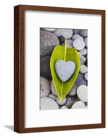 Heart Made of Stone on Green Leaves-Uwe Merkel-Framed Photographic Print