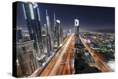 Centre of Dubai City, Panorama, Skyline, Evening Mood at Persian Gulf, Traffic-Axel Schmies-Stretched Canvas Print