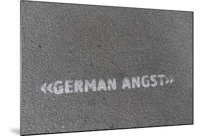 Writing 'German Angst' on a Footpath, Hamburg, Germany-Axel Schmies-Mounted Photographic Print