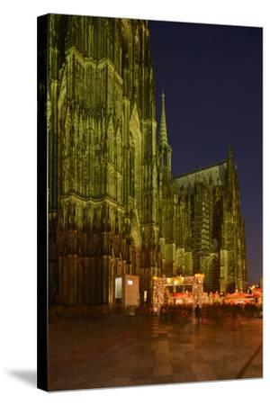 Germany, North Rhine-Westphalia, Cologne, Place Roncalli, Christmas Fair and Cologne Cathedral-Andreas Keil-Stretched Canvas Print