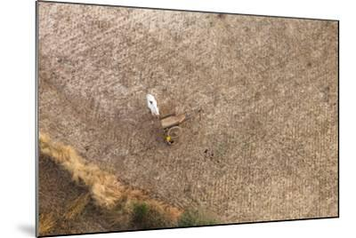 Aerial View of Farmer Working on a Field in Bagan, Myanmar-Harry Marx-Mounted Photographic Print