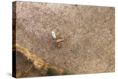 Aerial View of Farmer Working on a Field in Bagan, Myanmar-Harry Marx-Stretched Canvas Print