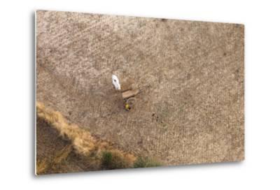 Aerial View of Farmer Working on a Field in Bagan, Myanmar-Harry Marx-Metal Print