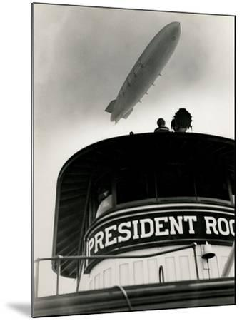 Airship Akron over Ferryboat President Roosevelt-P.L. Sperr-Mounted Photographic Print
