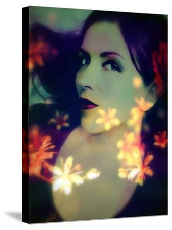 A Moody Evening Portrait of a Woman with Bright Flower Appearence-Alaya Gadeh-Stretched Canvas Print