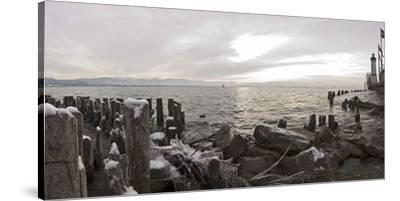 Wooden Poles Covered with Ice, Island Lindau in Lake Constance, Swedish Flag, Lighthouse, Lindau-Markus Leser-Stretched Canvas Print