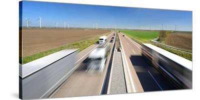 Germany, Saxony-Anhalt, Truck and Car in Motion Blur-Andreas Vitting-Stretched Canvas Print