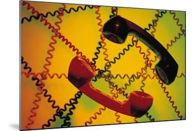 Telephone Receivers and Crisscross of Telephone Cords-Comstock-Mounted Photographic Print