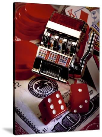 Dice, Slot Machine, Chips and Card on $100 Bill-Ellen Kamp-Stretched Canvas Print