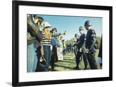 Female Demonstrator Offers a Flower to Military Police During the 1967 March on the Pentagon--Framed Photo