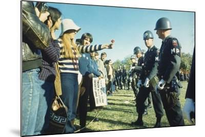 Female Demonstrator Offers a Flower to Military Police During the 1967 March on the Pentagon--Mounted Photo