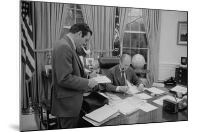 President Gerald Ford Meeting with His Chief of Staff, Donald Rumsfeld. Feb. 6, 1975--Mounted Photo
