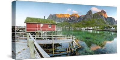 Panoramic of the Fishing Village Surrounded by Sea and Midnight Sun, Reine, Nordland County-Roberto Moiola-Stretched Canvas Print