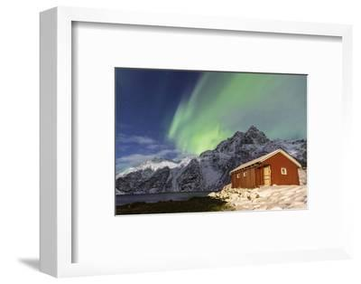 Northern Lights (Aurora Borealis) Illuminate Snowy Peaks and Wooden Cabin on a Starry Night-Roberto Moiola-Framed Photographic Print