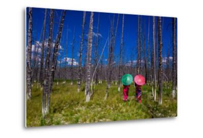 Two Girls with Parasols in Burnt Forest, Yellowstone National Park, Wyoming-Laura Grier-Metal Print