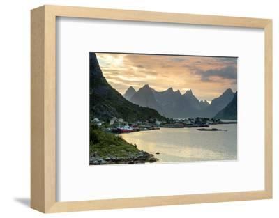Sunset on the Fishing Village Surrounded by Rocky Peaks and Sea, Reine, Nordland County-Roberto Moiola-Framed Photographic Print