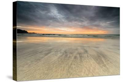 The Midnight Sun Reflected on the Sandy Beach of Skagsanden, Ramberg, Nordland County-Roberto Moiola-Stretched Canvas Print