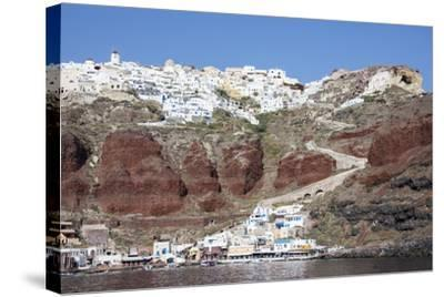 Typical Greek Village Perched on Volcanic Rock with White and Blue Houses and Windmills, Santorini-Roberto Moiola-Stretched Canvas Print