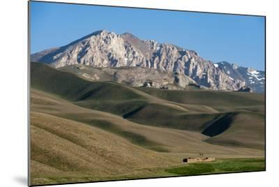 A Distant House in the Grasslands with Views of Mountains in the Distance, Bamiyan Province-Alex Treadway-Mounted Photographic Print