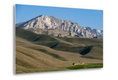 A Distant House in the Grasslands with Views of Mountains in the Distance, Bamiyan Province-Alex Treadway-Metal Print