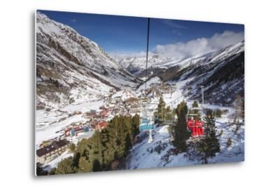 Village of Obergurgl Sat at Top of Otztal Valley as Skiers Ascend Mountain on Chairlifts-Garry Ridsdale-Metal Print