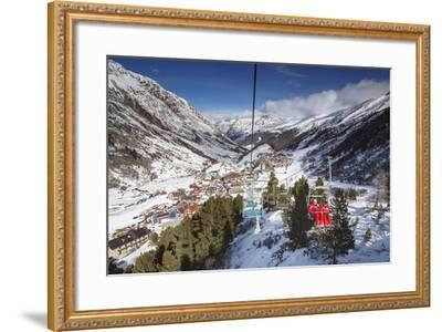 Village of Obergurgl Sat at Top of Otztal Valley as Skiers Ascend Mountain on Chairlifts-Garry Ridsdale-Framed Photographic Print