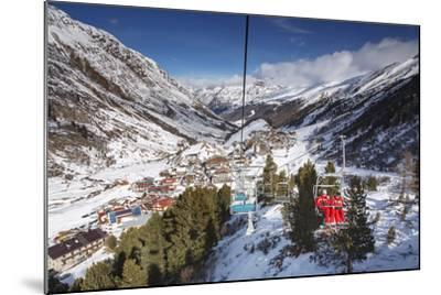 Village of Obergurgl Sat at Top of Otztal Valley as Skiers Ascend Mountain on Chairlifts-Garry Ridsdale-Mounted Photographic Print