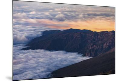 Clouds Obscure Coastal Villages Below Dark Volcanic Mountains of Tenerife's North East Coast-Garry Ridsdale-Mounted Photographic Print