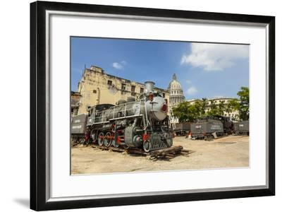 A Vintage Steam Train in a Restoration Yard with Dome of Former Parliament Building in Background-Sean Cooper-Framed Photographic Print