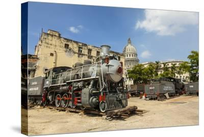 A Vintage Steam Train in a Restoration Yard with Dome of Former Parliament Building in Background-Sean Cooper-Stretched Canvas Print