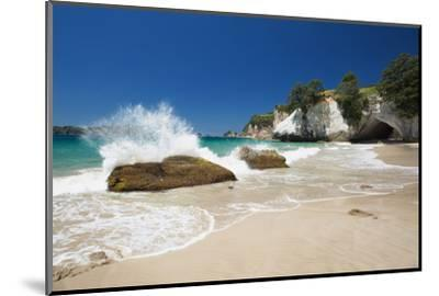 Waves Splashing Against Large Rocks on the Beach in Cathedral Cove, Coromandel, Waikato-Garry Ridsdale-Mounted Photographic Print