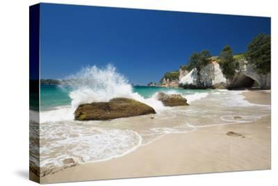 Waves Splashing Against Large Rocks on the Beach in Cathedral Cove, Coromandel, Waikato-Garry Ridsdale-Stretched Canvas Print