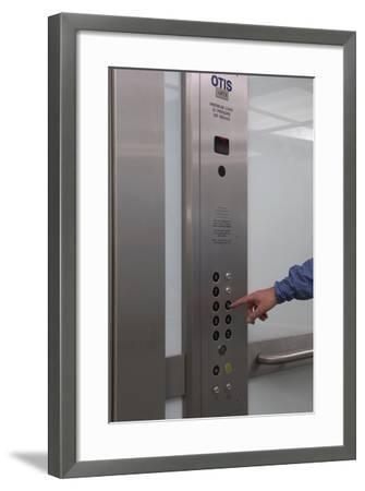 Man Pressing Lift Buttons, UK Office Interior-Richard Bryant-Framed Photo