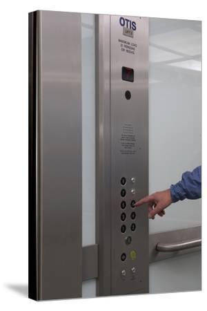Man Pressing Lift Buttons, UK Office Interior-Richard Bryant-Stretched Canvas Print