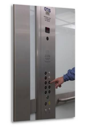 Man Pressing Lift Buttons, UK Office Interior-Richard Bryant-Metal Print