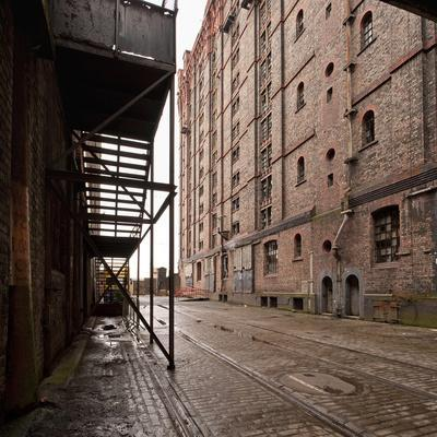 Old Tramlines in Cobbled Street with Shipping Warehouses in Liverpool, Merseyside, England, UK-Paul McMullin-Framed Photo