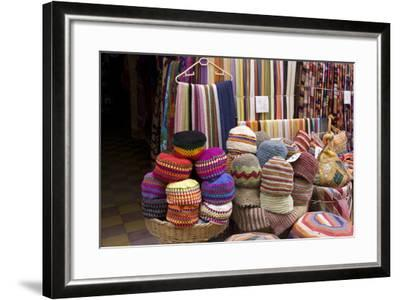 Fabrics, Tapestries, Cushions and Knitted Hats for Sale in the Souk, Essaouira, Morocco-Natalie Tepper-Framed Photo