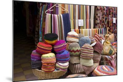 Fabrics, Tapestries, Cushions and Knitted Hats for Sale in the Souk, Essaouira, Morocco-Natalie Tepper-Mounted Photo