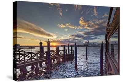 Cip's Club Restaurant and Mooring of the 5 Star Hotel Cipriani, at Sunset-Cahir Davitt-Stretched Canvas Print