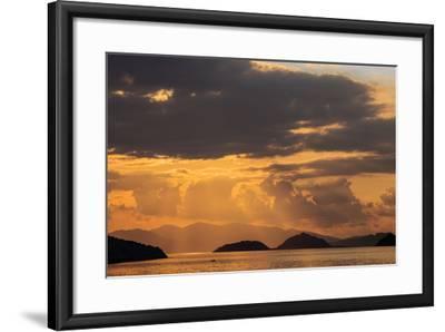 Indonesia, Lesser Sunda Islands, Rinca. Sunset over Komodo Island.-Nigel Pavitt-Framed Photographic Print