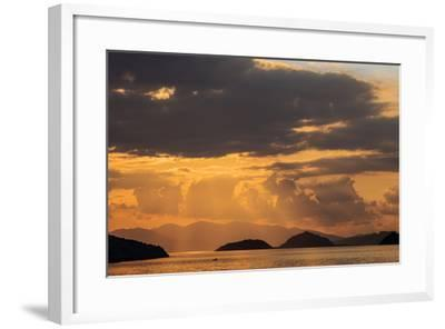 Indonesia, Lesser Sunda Islands, Rinca. Sunset over Komodo Island.-Nigel Pavitt-Framed Photographic Print