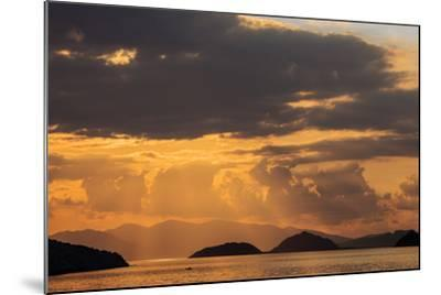 Indonesia, Lesser Sunda Islands, Rinca. Sunset over Komodo Island.-Nigel Pavitt-Mounted Photographic Print