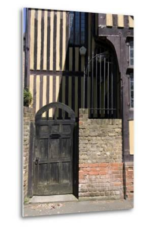 Timber Framed Building with Gate and Brick Wall in Tudor-Style House-Natalie Tepper-Metal Print