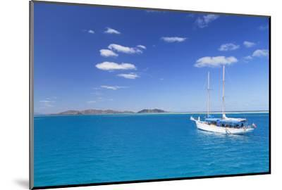 Yacht in Lagoon with Malolo Island, Mamanuca Islands, Fiji, South Pacific, Pacific-Ian Trower-Mounted Photographic Print