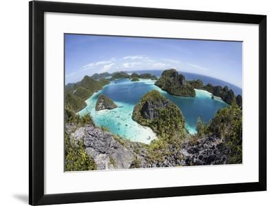 Rugged Limestone Islands Surround a Gorgeous Lagoon in Raja Ampat-Stocktrek Images-Framed Photographic Print
